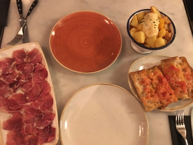 Procuitto, potatoes, and tomato/bread tapas.