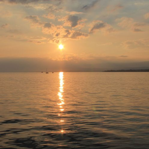 The setting sun over Lake Geneva in Lausanne